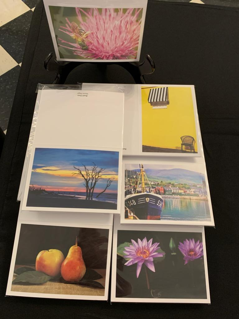 Four packets of note cards with photos of flowers, fruit, and scenery on them.